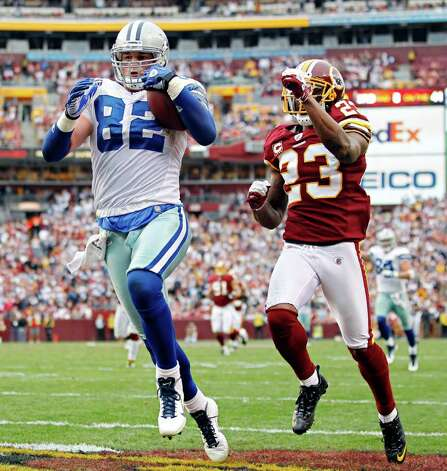 Dallas Cowboys tight end Jason Witten (82) stays ahead of Washington Redskins cornerback DeAngelo Hall to score during the second half as the Dallas Cowboys beat the Washington Redskins 27-24 in overtime at FedEx Field in Landover, Maryland, Sunday, November 20, 2011. Photo: G.J. McCarthy, Dallas Morning News / McClatchy-Tribune Photo Service 2011