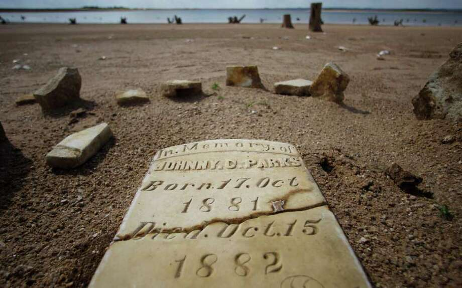 Normally at least 20 to 30 feet underwater, this child's grave is among the few that resurfaced during Texas' last drought on the dry, sandy Lake Buchanan near Bluffton. Photo: Eric Gay / AP