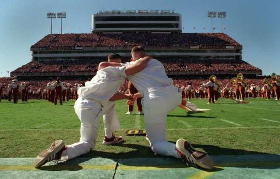Smiley N. Pool: Chronicle XXXXXXXXXXX: Texas A& M yell leaders Bubba Moser Jr., left, and Ricky Wood Jr., watchs as the Longhorn band performs 'Amazing Grace' during half time of the  Aggies win over the Longhorns 20-16  Friday, Nov. 26, 1999 in College Station, Texas. ()  HOUCHRON CAPTION (11/28/1999):  Texas A&M yell leaders Bubba Moser Jr., left, and Ricky Wood Jr., watch from the sideline as the University of Texas Longhorn band performs 'Amazing Grace' during half time in honor of the 12 Aggies who died last week in the Bonfire collapse. Photo: Smiley N. Pool / Houston Chronicle