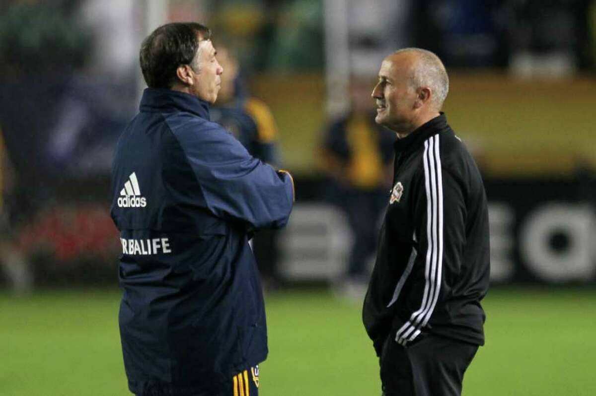 CARSON, CA - NOVEMBER 20: Head coach of the Los Angeles Galaxy Bruce Arena speaks with head coach of the Houston Dynamo Dominic Kinnear prior to the 2011 MLS Cup at The Home Depot Center on November 20, 2011 in Carson, California.