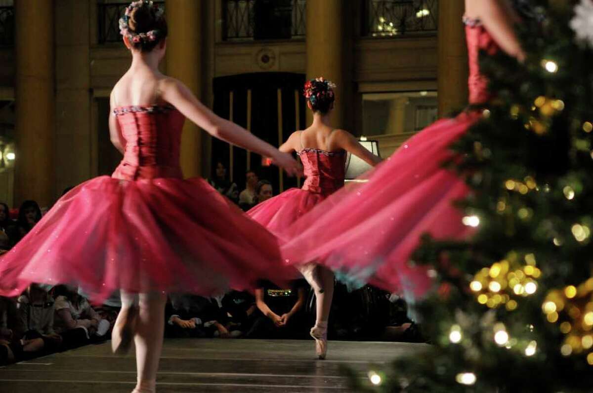 Members of the Northeast Ballet Company perform during the Nutcracker Tea at the Hall of Springs on Sunday, Nov. 20, 2011 in Saratoga Springs, NY. The Saratoga Performing Arts Center fundraiser is hosted by the Action Council, SPACs largest volunteer fundraising arm, according to Gerry Golub, president of the council. Dancers with the Northeast Ballet Company performed excerpts from the Nutcracker. The company will perform the full ballet in December at Proctors. Last year the council held two teas because of the demand and this year they continued with a morning and an afternoon tea. Lorraine Laczko chair of the event said that they sold out both sessions of this years event and they even had a waiting list. (Paul Buckowski / Times Union)