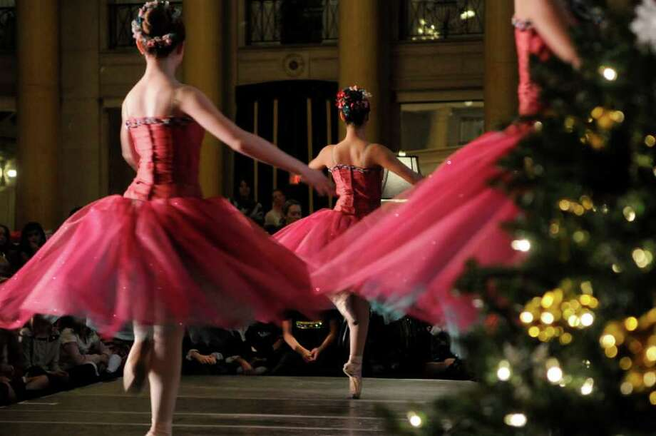 Members of the Northeast Ballet Company perform during the Nutcracker Tea at the Hall of Springs on Sunday, Nov. 20, 2011 in Saratoga Springs, NY.  The Saratoga Performing Arts Center fundraiser is hosted by the Action Council, SPACs largest volunteer fundraising arm, according to Gerry Golub, president of the council.  Dancers with the Northeast Ballet Company performed excerpts from the Nutcracker.  The company will perform the full ballet in December at Proctors.  Last year the council held two teas because of the demand and this year they continued with a morning and an afternoon tea.  Lorraine Laczko chair of the event said that they sold out both sessions of this years event and they even had a waiting list. (Paul Buckowski / Times Union) Photo: Paul Buckowski