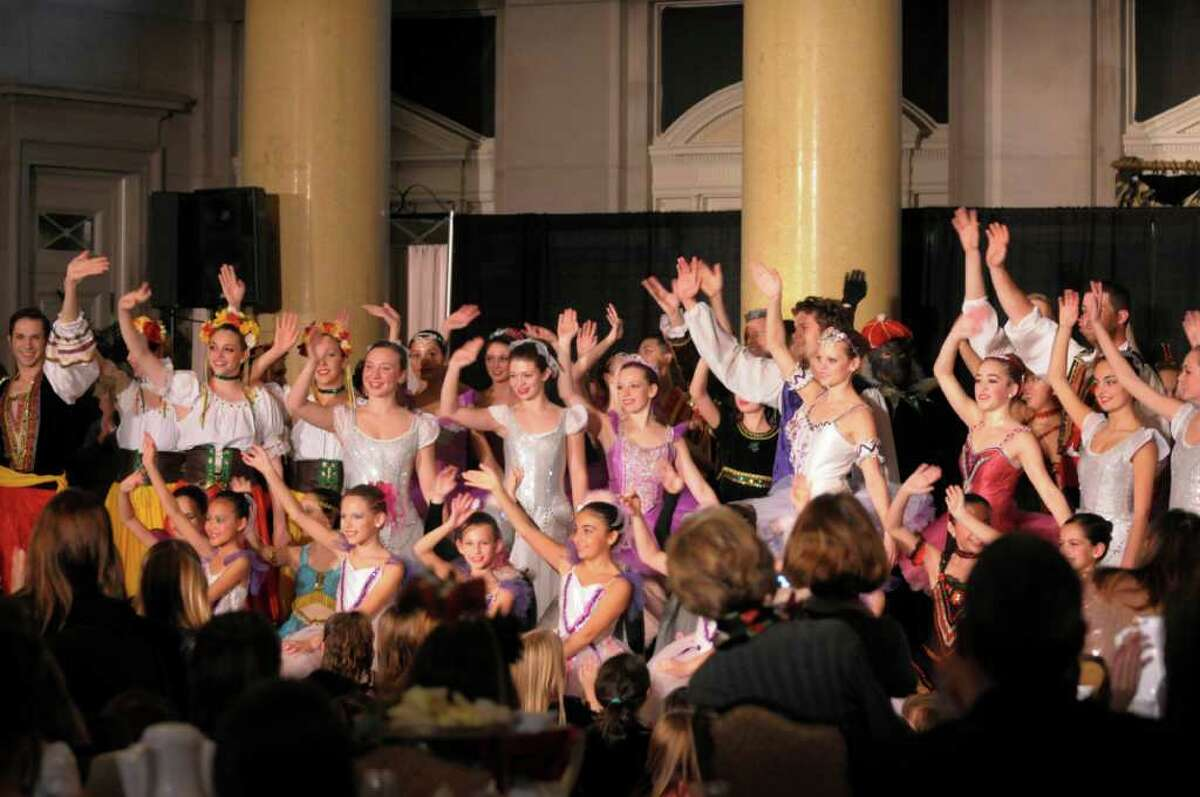 Members of the Northeast Ballet Company wave to the audience at the end of their show during the Nutcracker Tea at the Hall of Springs on Sunday, Nov. 20, 2011 in Saratoga Springs, NY. The Saratoga Performing Arts Center fundraiser is hosted by the Action Council, SPACs largest volunteer fundraising arm, according to Gerry Golub, president of the council. Dancers with the Northeast Ballet Company performed excerpts from the Nutcracker. The company will perform the full ballet in December at Proctors. Last year the council held two teas because of the demand and this year they continued with a morning and an afternoon tea. Lorraine Laczko chair of the event said that they sold out both sessions of this years event and they even had a waiting list. (Paul Buckowski / Times Union)
