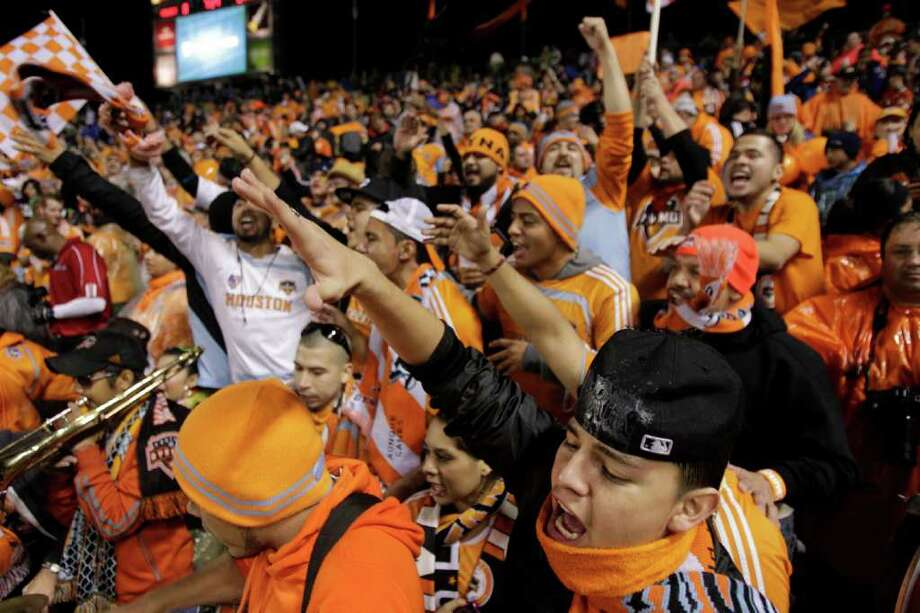 Houston Dynamo fans cheer their team before the MLS Cup soccer match at the Home Depot Center Sunday, Nov. 20, 2011, in Carson, Calif. Photo: Brett Coomer, Houston Chronicle / © 2011 Houston Chronicle
