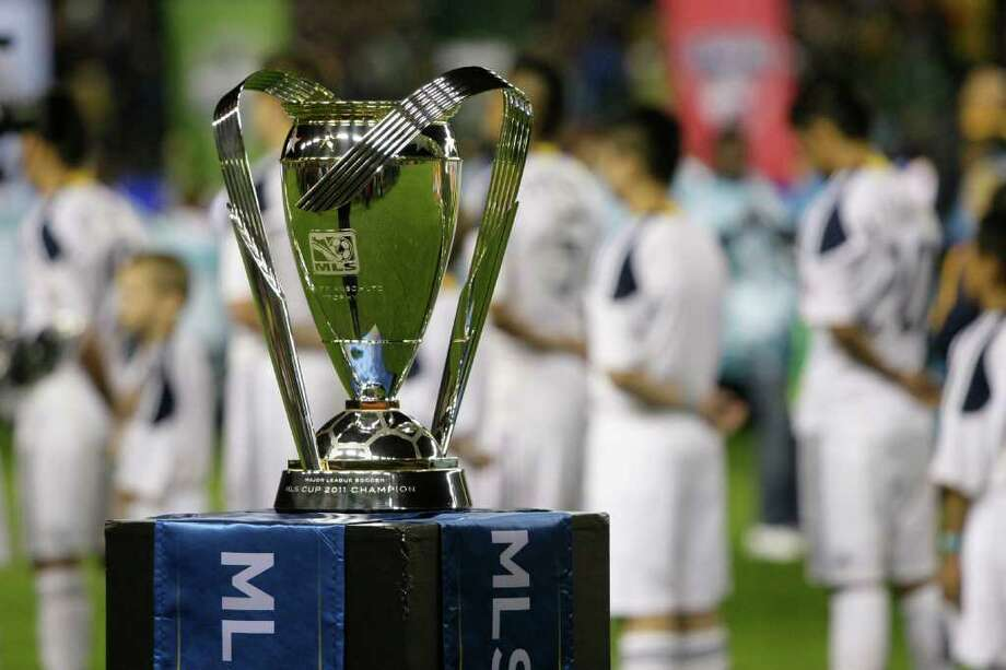The championship trophy is seen as the Los Angeles Galaxy stand for the anthem before the MLS Cup soccer match at the Home Depot Center Sunday, Nov. 20, 2011, in Carson, Calif. Photo: Brett Coomer, Houston Chronicle / © 2011 Houston Chronicle