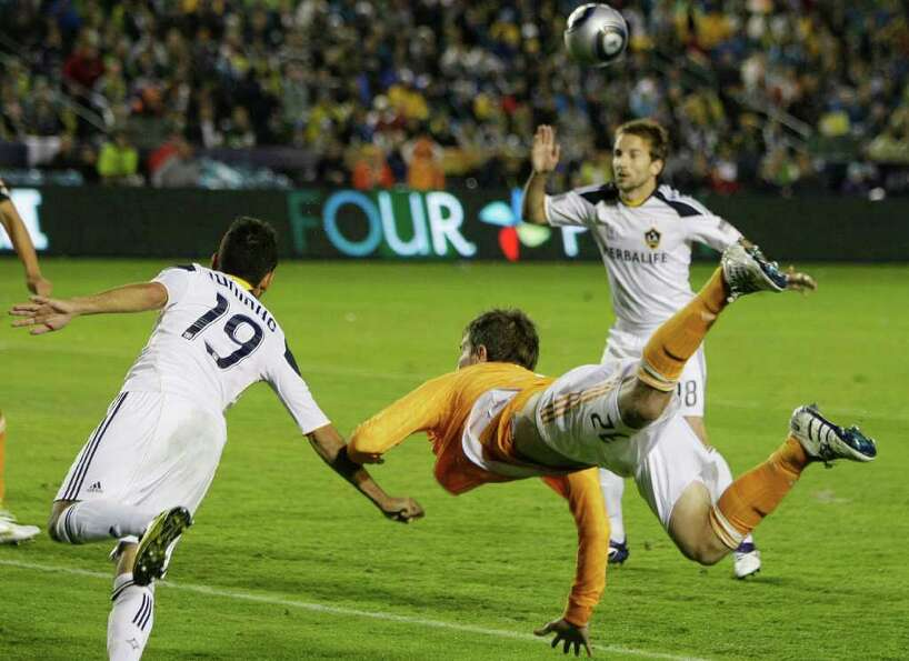 Houston Dynamo defender Bobby Boswell (32) dives for a ball against Los Angeles Galaxy midfielder Ju