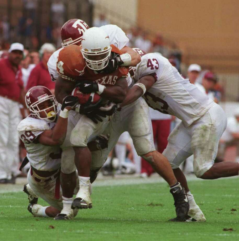 MARK MADE: The UT-A&M rivalry has been filled with memorable performances, like Ricky Williams' rushing for 259 yards in the Horns' 26-24 win in 1998, which gave him the major college career record. Photo: Kerwin Plevka / Houston Chronicle