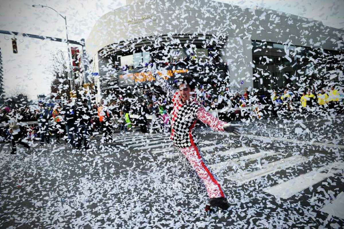 A Cirque-tacular performer dances in a blast of confetti as the UBS Parade Spectacular welcomed tens of thousands to downtown Stamford Sunday, November 20, 2011. The most welcome guest, though, was the clear skies and temperatures in the low 60s.