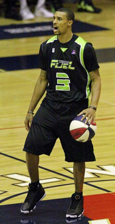 Former Spurs guard George Hill, playing for the Texas Fuel, calls a play in Sunday's game against the Hill Country Stampede. He had a triple-double. Photo: EDWARD A. ORNELAS, Express-News / © SAN ANTONIO EXPRESS-NEWS (NFS)