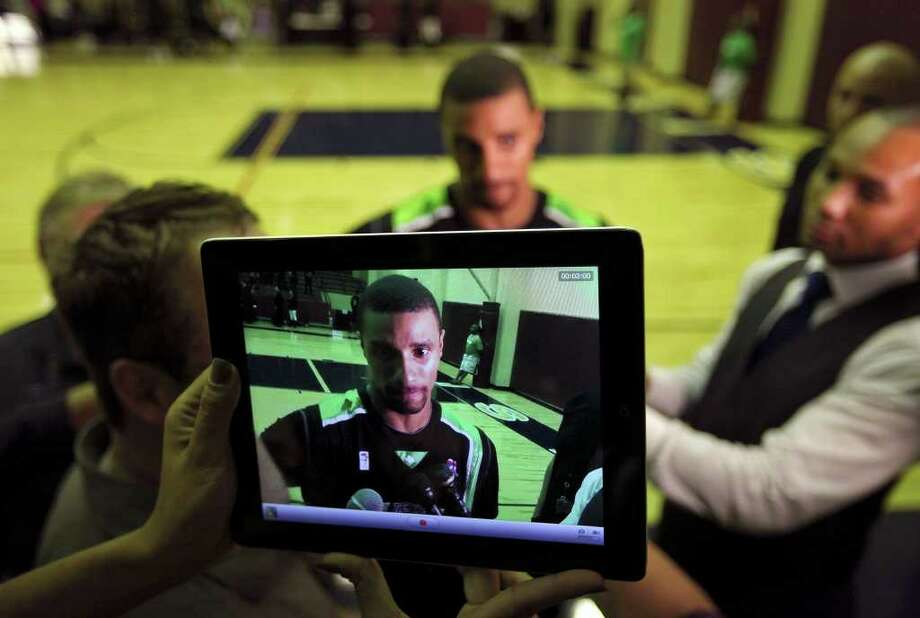 Former Spurs guard George Hill is recorded with an iPad as he answers questions from the media during halftime of the Texas Fuel and Hill Country Stampede game Sunday Nov. 20, 2011 at Alamo Convocation Center. Hill was playing for the Texas Fuel. Photo: EDWARD A. ORNELAS, Express-News / © SAN ANTONIO EXPRESS-NEWS (NFS)