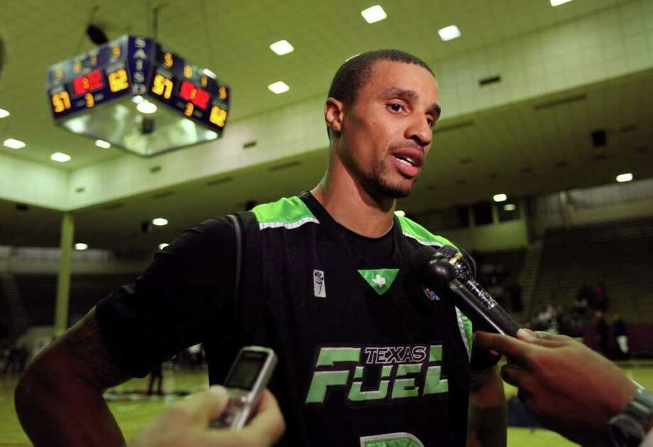Former Spurs guard George Hill answers questions from the media during halftime of the Texas Fuel and Hill Country Stampede game Sunday Nov. 20, 2011 at Alamo Convocation Center. Hill was playing for the Texas Fuel. Photo: EDWARD A. ORNELAS, Express-News / © SAN ANTONIO EXPRESS-NEWS (NFS)