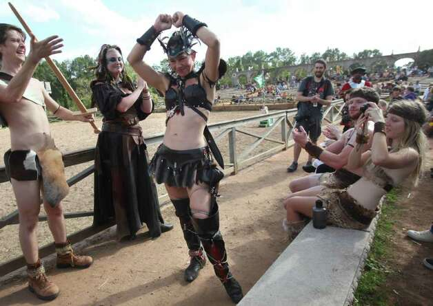 (center) Participant Cassandra Coleman is cheered by the crowd as she is told she is 1st place winner during the Best Dressed Barbarian Contest at the Renaissance Festival on Sunday, Nov. 20, 2011, in Plantersville. ( Mayra Beltran / Houston Chronicle ) Photo: Mayra Beltran / © 2011 Houston Chronicle