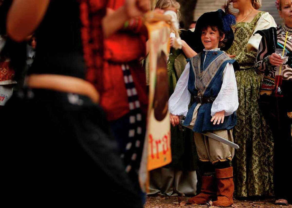 Zane Daniel, 7, wears a musketeer costume as he smiles at parade participants during the Renaissance Festival on Sunday, Nov. 20, 2011, in Plantersville. ( Mayra Beltran / Houston Chronicle )