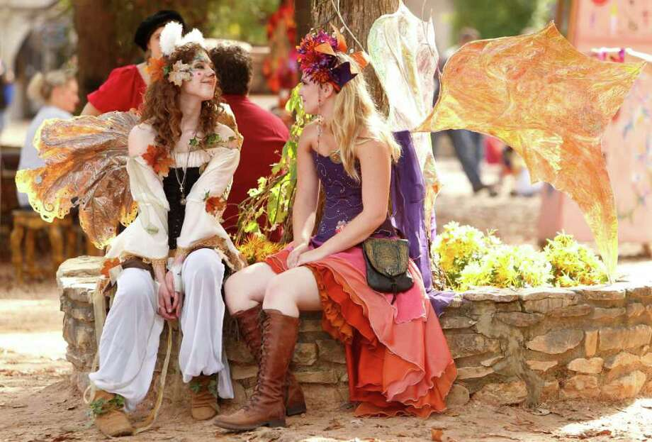 """Aspen Fairy"" Miranda Adams, 17, and ""Queen Titiana"" Alicia Barnhardt rest in the shade at the  Renaissance Festival on Sunday, Nov. 20, 2011, in Plantersville. ( Mayra Beltran / Houston Chronicle ) Photo: Mayra Beltran / © 2011 Houston Chronicle"