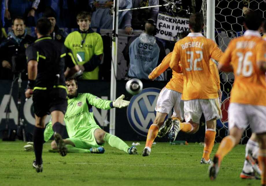 A shot by during Los Angeles Galaxy forward Landon Donovan (10) gets past Houston Dynamo goalkeeper Tally Hall (1) in the 72nd minute the second half of the MLS Cup soccer match at the Home Depot Center Sunday, Nov. 20, 2011, in Carson, Calif. Photo: Brett Coomer, Houston Chronicle / © 2011 Houston Chronicle
