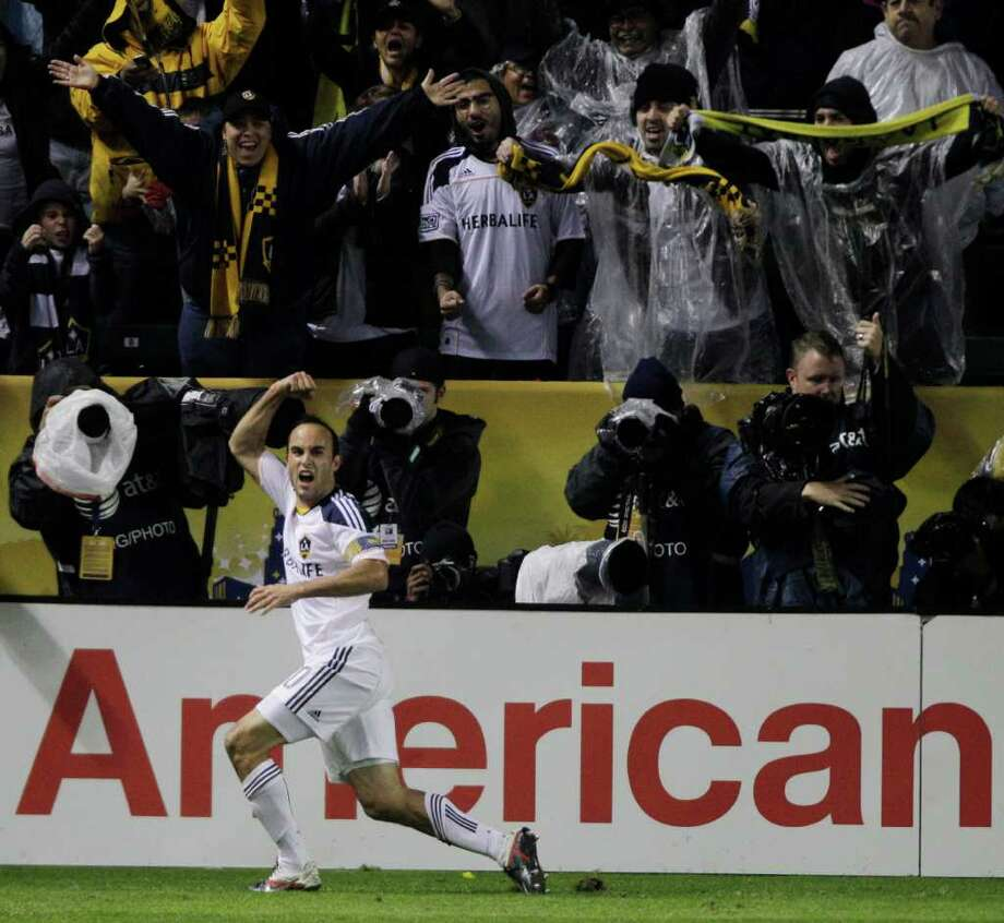Los Angeles Galaxy forward Landon Donovan (10) celebrates after scoring in the 72nd minute the second half of the MLS Cup soccer match against the Houston Dynamo at the Home Depot Center Sunday, Nov. 20, 2011, in Carson, Calif. Photo: Brett Coomer, Houston Chronicle / © 2011 Houston Chronicle
