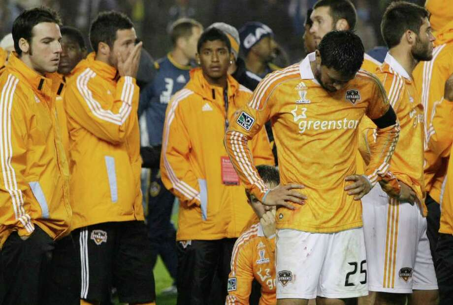 Houston Dynamo forward Brian Ching (25) hangs his head after the MLS Cup soccer match at the Home Depot Center Sunday, Nov. 20, 2011, in Carson, Calif. The Los Angeles Galaxy beat the Dyanamo 1-0 for the title. Photo: Brett Coomer, Houston Chronicle / © 2011 Houston Chronicle