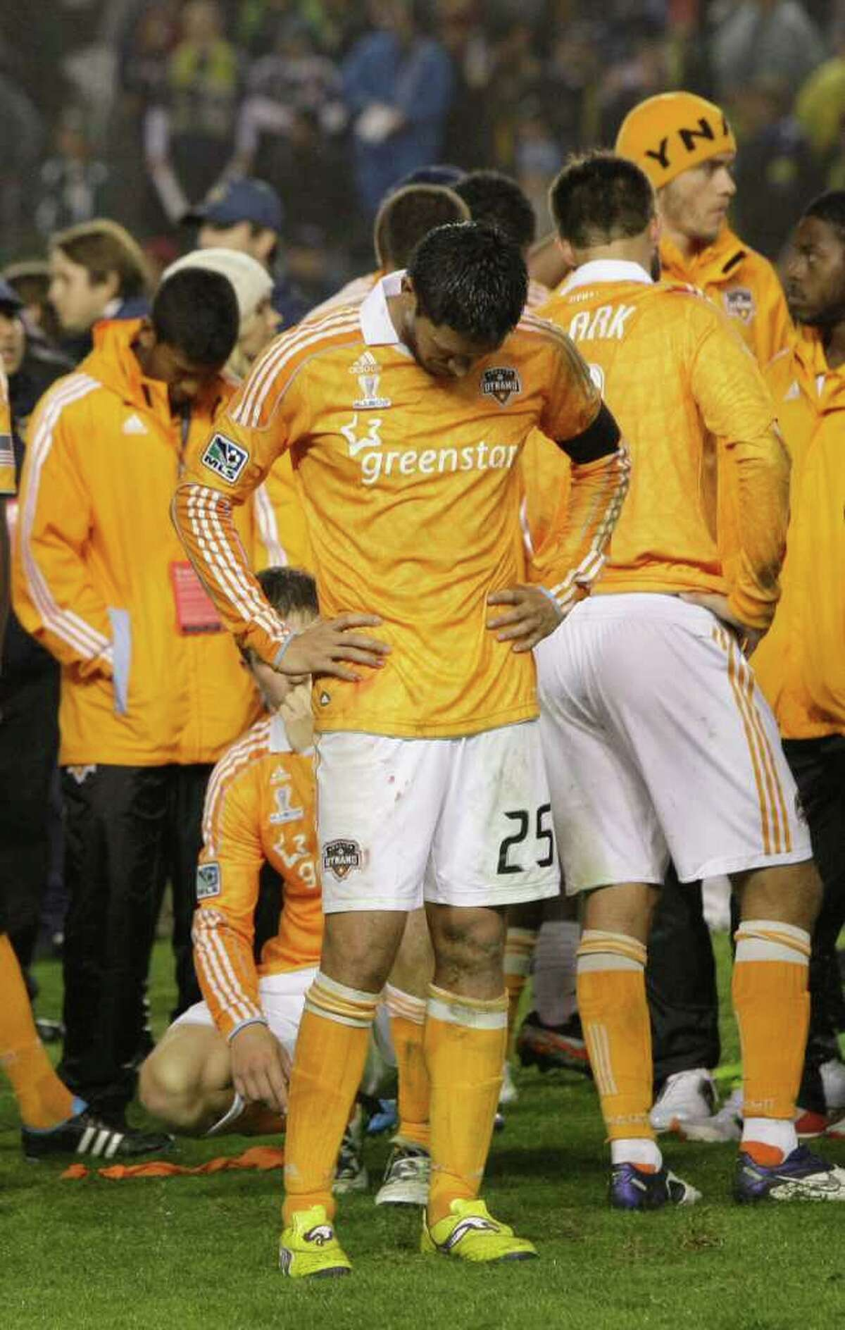 Houston Dynamo forward Brian Ching (25) hangs his head after the MLS Cup soccer match at the Home Depot Center Sunday, Nov. 20, 2011, in Carson, Calif. The Los Angeles Galaxy beat the Dyanamo 1-0 for the title.