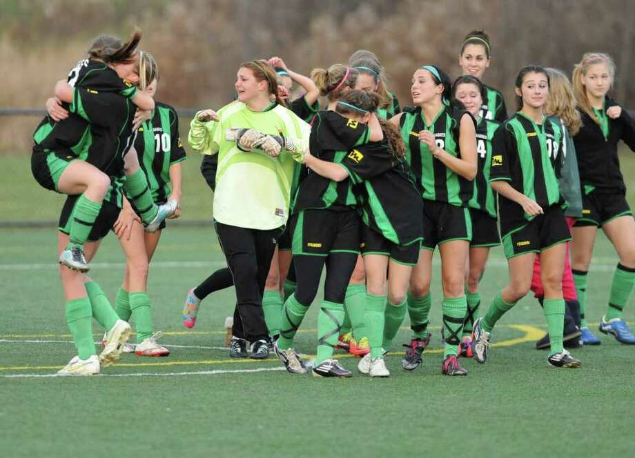 Schalmont celebrates after winning the class B state finals soccer game against Greece Odyssey at Tompkins-Cortland Community College in Cortland, N.Y. Sunday, Nov. 20, 2011. (Lori Van Buren / Times Union) Photo: Lori Van Buren
