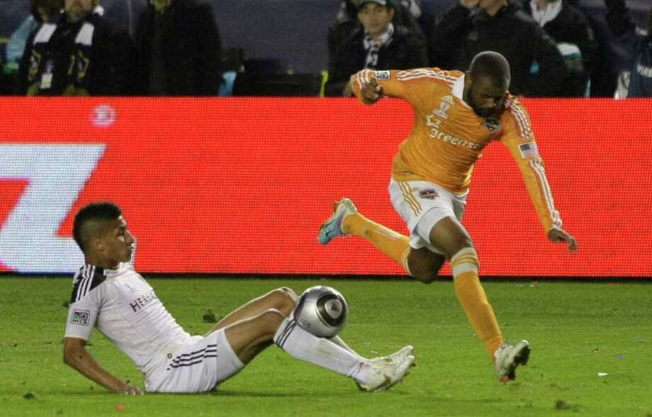 Houston Dynamo defender Mike Chabala (17) and Los Angeles Galaxy defender Sean Franklin (5) fight for a ball during the second  half of the MLS Cup soccer match at the Home Depot Center Sunday, Nov. 20, 2011, in Carson, Calif. Photo: Brett Coomer, Houston Chronicle / © 2011 Houston Chronicle