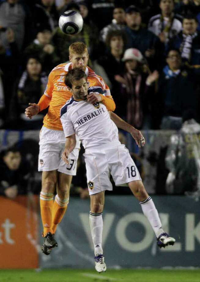 Houston Dynamo defender Andre Hainault (31) and Los Angeles Galaxy forward Mike Magee (18) fight for a header during the first half of the MLS Cup soccer match at the Home Depot Center Sunday, Nov. 20, 2011, in Carson, Calif. Photo: Brett Coomer, Houston Chronicle / © 2011 Houston Chronicle