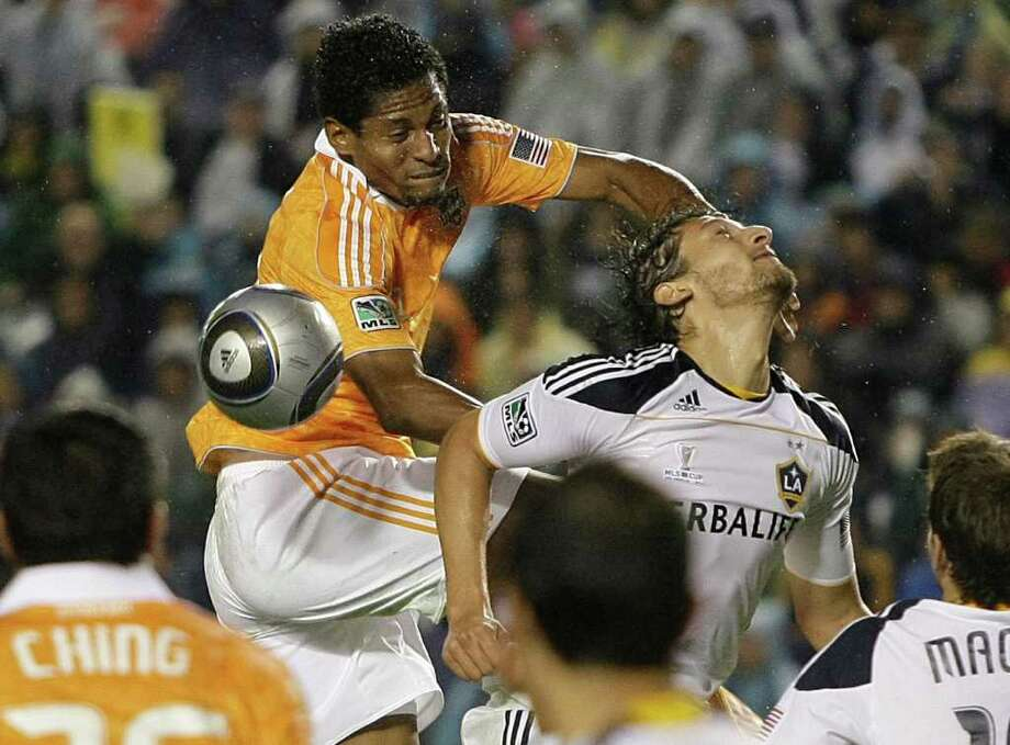 Nov. 20: Galaxy 1, Dynamo 0 Houston Dynamo forward Carlos Costly (29) collides with Los Angeles Galaxy defender Omar Gonzalez (4) going for a header during the second half of the MLS Cup soccer match at the Home Depot Center Sunday, Nov. 20, 2011, in Carson, Calif. The Galaxy beat the Dyanamo 1-0 for the title. Photo: Brett Coomer, Houston Chronicle / © 2011 Houston Chronicle