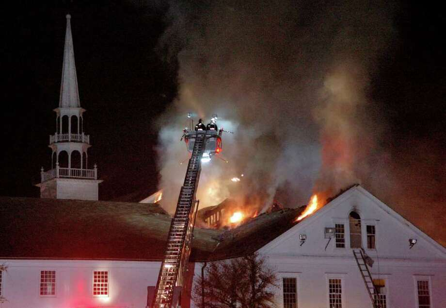 Firefighters battle a fire in the historic Saugatuck Congregational Church on Post Road East in Westport, Conn. on Sunday Nov. 20, 2011. The blaze consumed the back of the structure where the administrative offices are. Photo: Cathy Zuraw / Connecticut Post