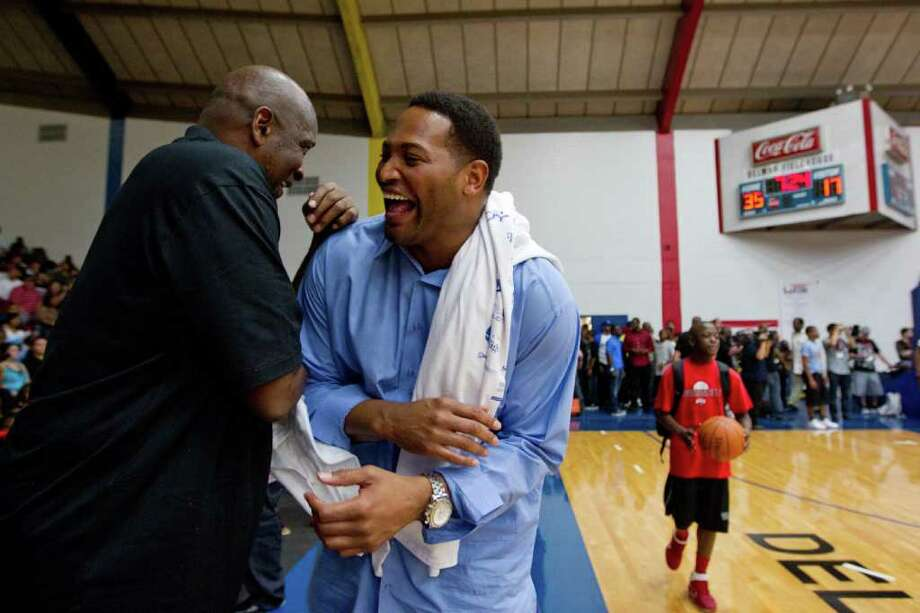 Former Rockets Moses Malone, left, and Robert Horry laugh with each other while serving as the celebrity coaches for the Houston Lockout Celebrity Basketball Game game at Delmar Fieldhouse on Sunday, Nov. 20, 2011, in Houston. Photo: Smiley N. Pool, Houston Chronicle / © 2011  Houston Chronicle