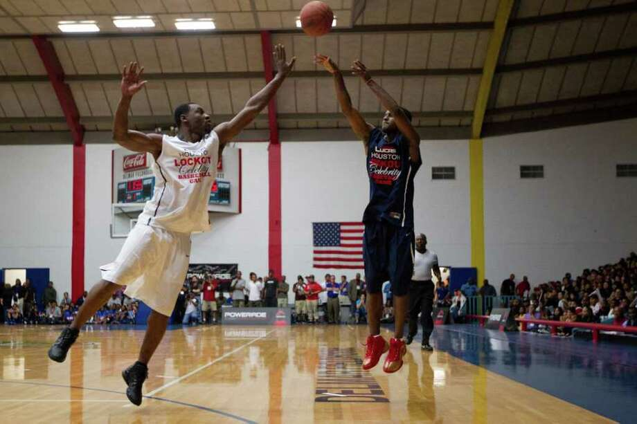 John Lucas III of the Chicago Bulls shoots over Tony Allen of Memphis Grizzlies during the Houston Lockout Celebrity Basketball Game game at Delmar Fieldhouse on Sunday, Nov. 20, 2011, in Houston. Photo: Smiley N. Pool, Houston Chronicle / © 2011  Houston Chronicle