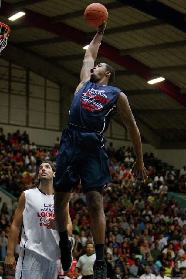DeAndre Jordan of the Los Angeles Clippers dunks the ball over Luis Scola of the Houston Rockets during the Houston Lockout Celebrity Basketball Game game at Delmar Fieldhouse on Sunday, Nov. 20, 2011, in Houston. Photo: Smiley N. Pool, Houston Chronicle / © 2011  Houston Chronicle