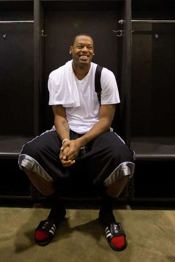 Marcus Camby of the Portland Trailblazers smiles as he sits in a locker room at at Delmar Fieldhouse before the Houston Lockout Celebrity Basketball Game game on Sunday, Nov. 20, 2011, in Houston. Photo: Smiley N. Pool, Houston Chronicle / © 2011  Houston Chronicle