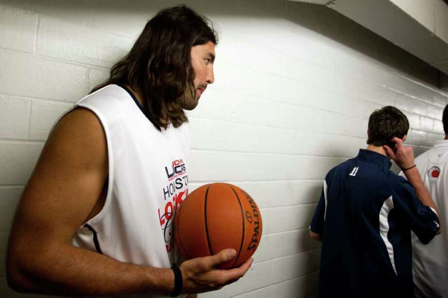 Luis Scola of the Houston Rockets waits to take the court to warm up before the Houston Lockout Celebrity Basketball Game game at Delmar Fieldhouse on Sunday, Nov. 20, 2011, in Houston. Photo: Smiley N. Pool, Houston Chronicle / © 2011  Houston Chronicle