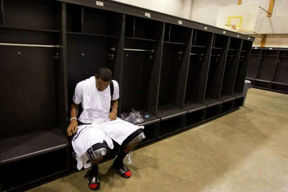 Marcus Camby of the Portland Trailblazers sorts through his game uniform as he sits in a locker room at Delmar Fieldhouse before the Houston Lockout Celebrity Basketball Game game on Sunday, Nov. 20, 2011, in Houston. Photo: Smiley N. Pool, Houston Chronicle / © 2011  Houston Chronicle