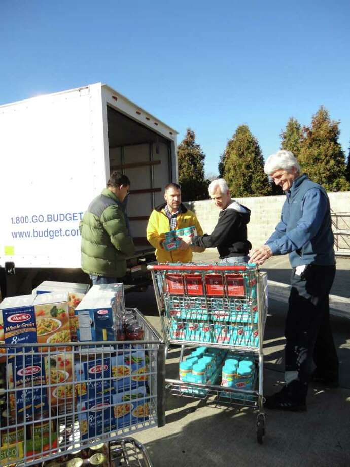 Priceline employees take part in the company's annual food drive for the Food Bank of Lower Fairfield County Friday. Photo: Meg Barone