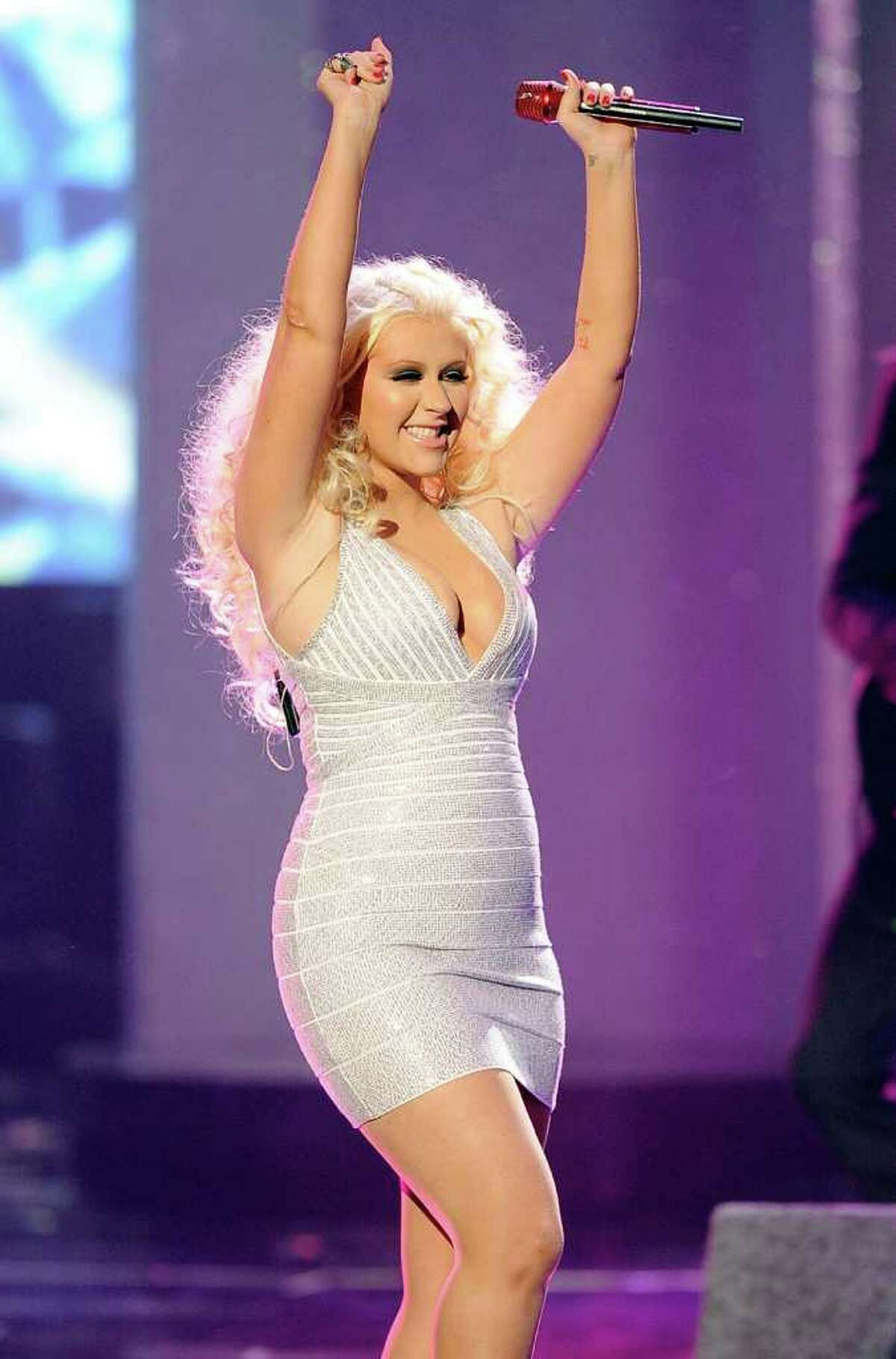 LOS ANGELES, CA - NOVEMBER 20: Singer Christina Aguilera performs onstage at the 2011 American Music Awards held at Nokia Theatre L.A. LIVE on November 20, 2011 in Los Angeles, California.