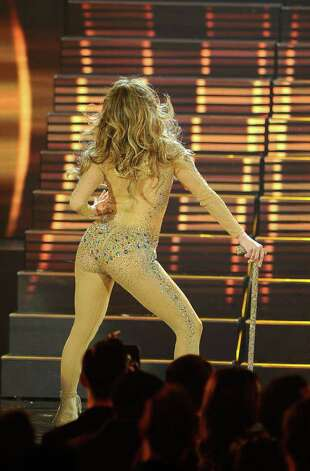 LOS ANGELES, CA - NOVEMBER 20:  Singer Jennifer Lopez (C) performs onstage at the 2011 American Music Awards held at Nokia Theatre L.A. LIVE on November 20, 2011 in Los Angeles, California. Photo: Kevork Djansezian, Getty Images / 2011 Getty Images