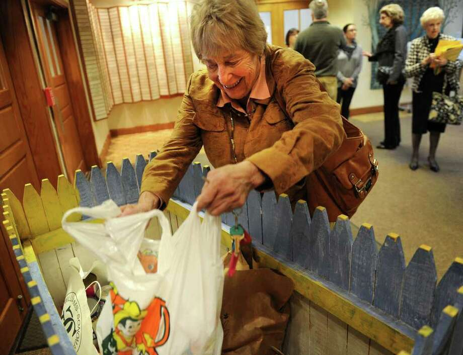 Teri Klein of Westport donates food items at An Interfaith Thanksgiving Celebration at The Conservative Synagogue in Westport on Sunday, November 20, 2011. Photo: Brian A. Pounds / Connecticut Post