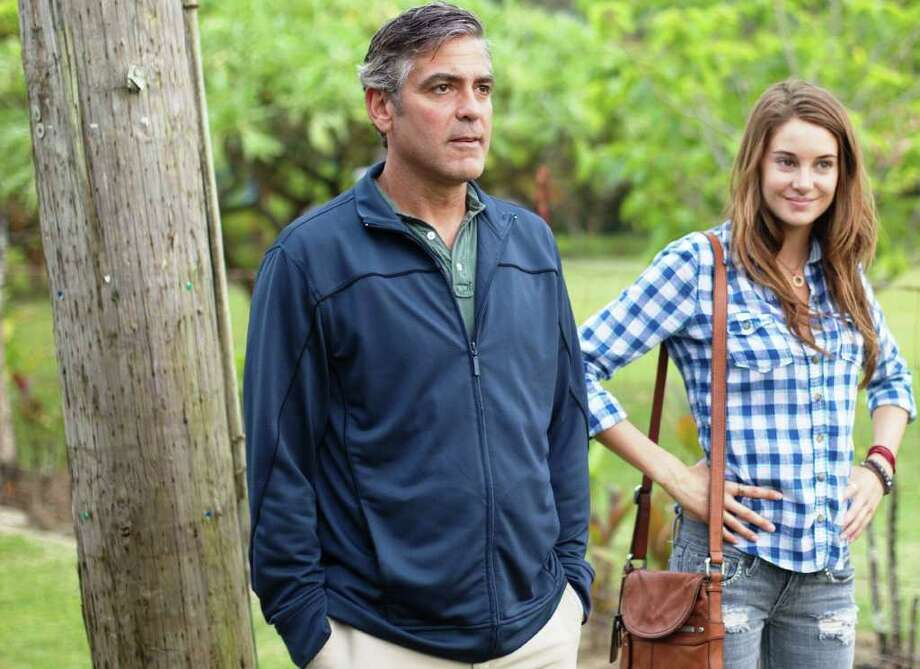 "George Clooney plays Matt King, and Shailene Woodley is his daughter Alexandra in ""The Descendants."" Photo: FOX SEARCHLIGHT PICTURES"
