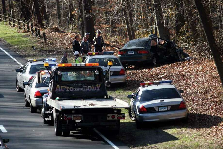 State police spokesman Lt. J. Paul Vance said one person was killed Monday morning, Nov. 21, 2011, in a single-car accident on the southbound Merritt Parkway near exit 44 in Fairfield, Conn. when a car went off the road and crashed into a tree. Photo: B.K. Angeletti / Connecticut Post