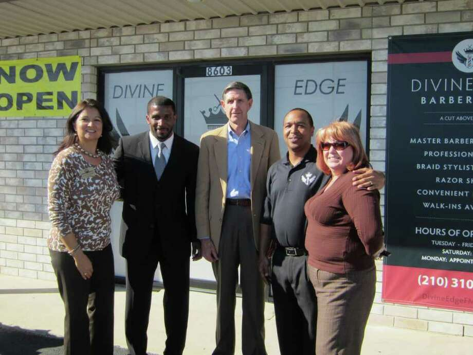 Former NFL running back Priest Holmes (second left) joins Boysville CEO Lt. Gen. David McIlvoy (center), Divine Edge master barber Oscar Dean and the Randolph Metrocom Chamber of Commerce's Elsa Cranford (left) and Cassandra Miller (right) at the Divine Edge grand opening Nov. 10 in Converse. Photo: Submitted Photo