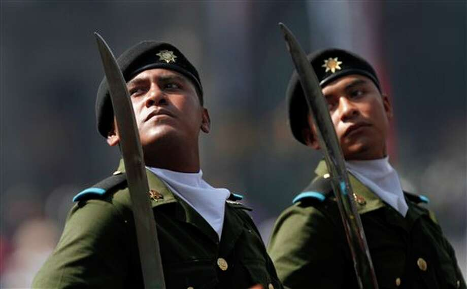 Soldiers parade as part of Mexican Revolution 101th anniversary celebrations in Mexico City's Zocalo plaza, Sunday Nov. 20, 2011. Mexico marks 101 years since the seven-year conflict began on Nov. 20, 1910 that saw peasant armies led by heroes Emiliano Zapata and Pancho Villa topple the dictatorship of Porfirio Diaz. (AP Photo/Marco Ugarte) Photo: Associated Press