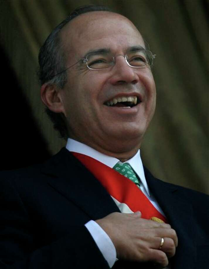 **  CORRECTS YEAR  ** Mexico's President Felipe Calderon smiles as he attends a parade commemorating the 101 anniversary of the Mexican Revolution in Mexico City's Zocalo plaza, Sunday Nov. 20, 2011. Mexico marks 101 years since the seven-year conflict began on Nov. 20, 1910 that saw peasant armies led by heroes Emiliano Zapata and Pancho Villa topple the dictatorship of Porfirio Diaz. (AP Photo/Marco Ugarte) Photo: Associated Press