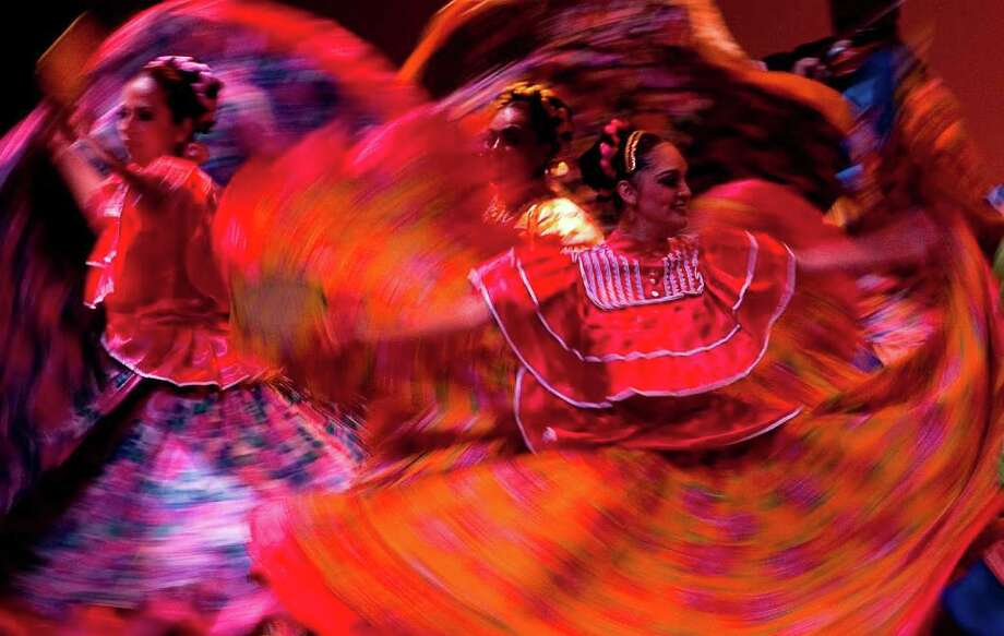Dancers of the Folkloric Ballet of the University of Guadalajara (Mexico), perform during the Bogota Dance Festival at the Julio Mario Santo Domingo Theatre in Bogota on November 20, 2011.  AFP PHOTO/LUIS ACOSTA Photo: LUIS ACOSTA, Getty Images / 2011 AFP