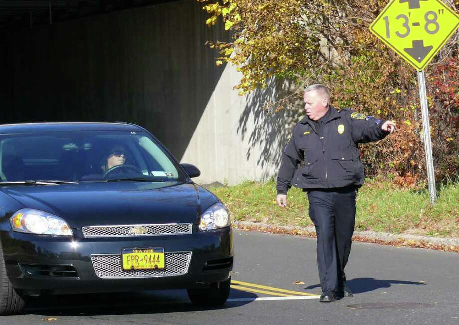 "Officer Gary Wikman pulls over a car whose driver was not wearing a seatbelt during  ""Click It or Ticket"" enforcement. Photo: Genevieve Reilly / Fairfield Citizen"
