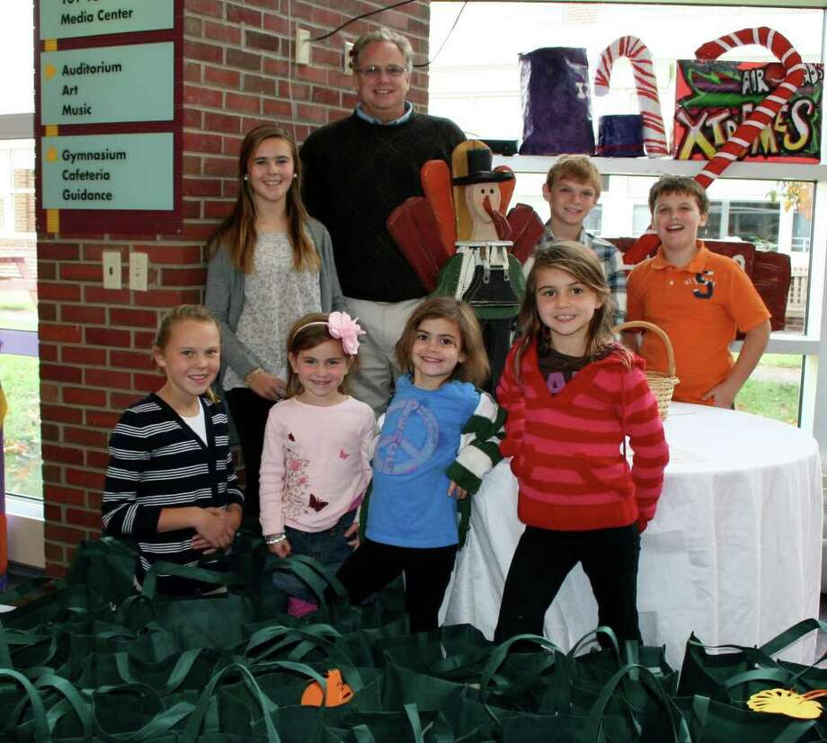 Those who have helped the Bridgeport Rescue Mission at Grace Church include, back row, from left,  Emma Crowley, Bridgeport Rescue Mission liaison David McKenna, Chasen Britt and Jack Harrison. Front row, Abby Crowley, Reese Quinn, Reagan Quinn and Olivia Quinn. Photo: Contributed Photo