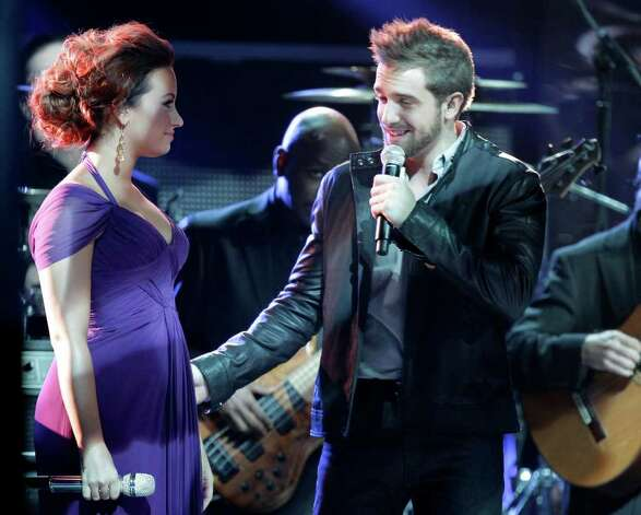 Demi Lovato, left, and Pablo Alboran perform at the 12th Annual Latin Grammy Awards on Thursday Nov. 10, 2011 in Las Vegas. Photo: AP