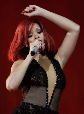 Rihanna revs up the audience during live shows. Her new CD has elements of club music. Photo: Joel Ryan, Houston Chronicle / AP
