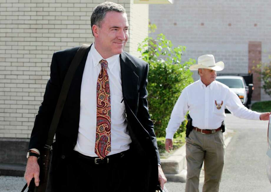 Judge William Adams returns after a lunch recess at the Aransas County Courthouse in Rockport, Texas, on Monday, Nov. 21, 2011. Adams is fighting for visitation with his 10-year-old daughter after a temporary restraining order was issued, barring him from visiting the girl without getting permission from her mother, his ex-wife Hallie Adams. The restraining order was issued following the October posting of a 2004 video on YouTube showing Adams beating his older daughter, Hillary Adams. (AP Photo/Corpus Christi Caller-Times, Michael Zamora) MAGS OUT; TV OUT Photo: Michael Zamora, AP / AP2011