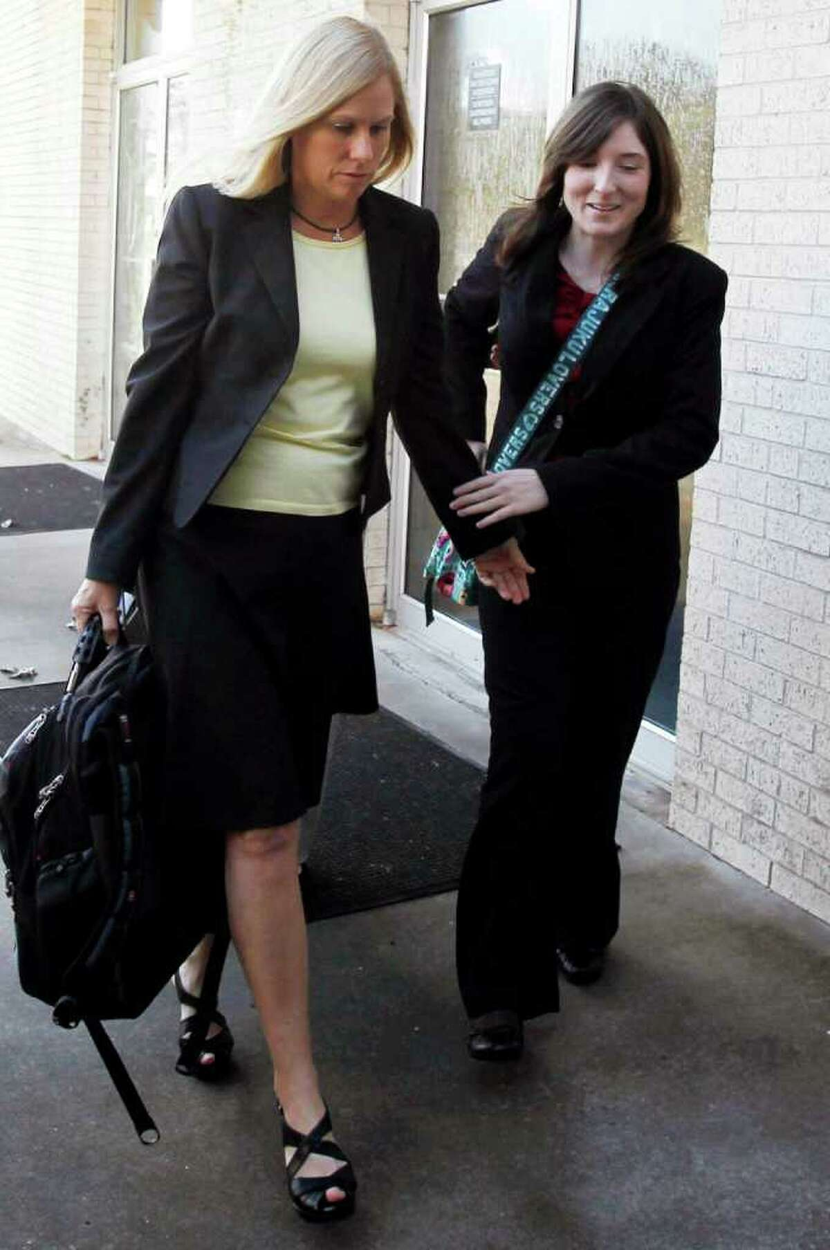 Hallie Adams, left, and her daughter, Hillary Adams, arrive at the Aransas County Courthouse in Rockport, Texas, on Monday, Nov. 21, 2011. Hallie Adams ex-husband, Judge William Adams, is fighting for visitation with his 10-year-old daughter after a temporary restraining order was issued, barring him from visiting the girl without getting permission from her mother, his ex-wife Hallie Adams. The restraining order was issued following the October posting of a 2004 video on YouTube showing Adams beating his older daughter, Hillary Adams. (AP Photo/Corpus Christi Caller-Times, Michael Zamora) MAGS OUT; TV OUT