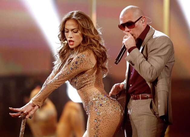 Jennifer Lopez, left, and Pitbull perform at the 39th Annual American Music Awards on Sunday, Nov. 20, 2011 in Los Angeles. Photo: AP
